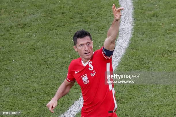 Poland's forward Robert Lewandowski celebrates after scoring his team's first goal during the UEFA EURO 2020 Group E football match between Sweden...