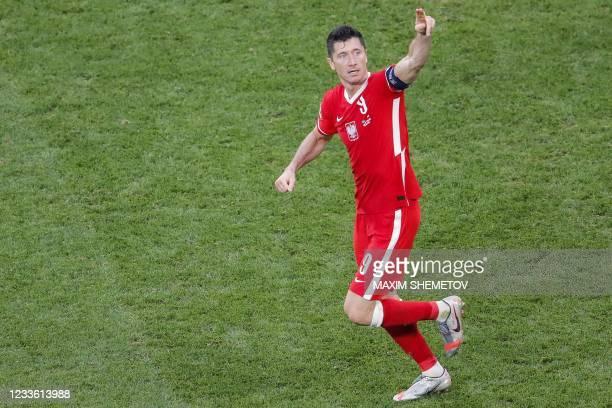 Poland's forward Robert Lewandowski celebrates after scoring his team's second goal during the UEFA EURO 2020 Group E football match between Sweden...