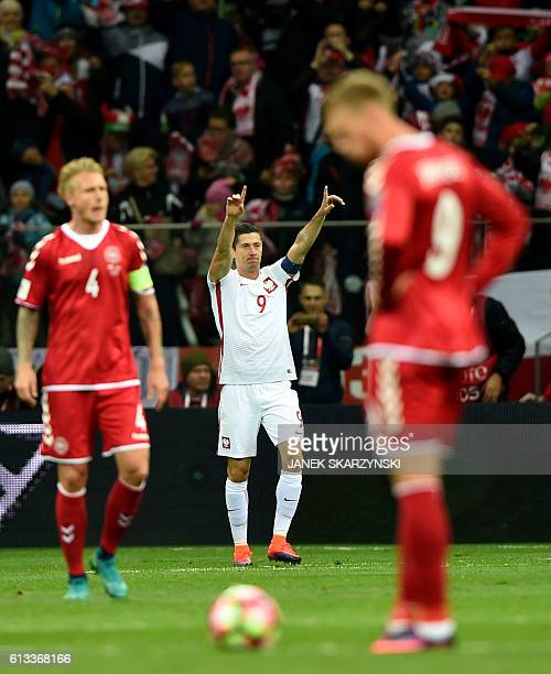 Poland's forward Robert Lewandowski celebrates after scoring the 10 during the 2018 World Cup qualifier football match of Poland vs Denmark in Warsaw...