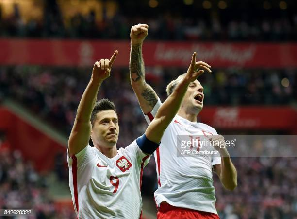 Poland's forward Robert Lewandowski celebrates scoring his sides's third goal during the FIFA World Cup 2018 qualification match between Poland and...