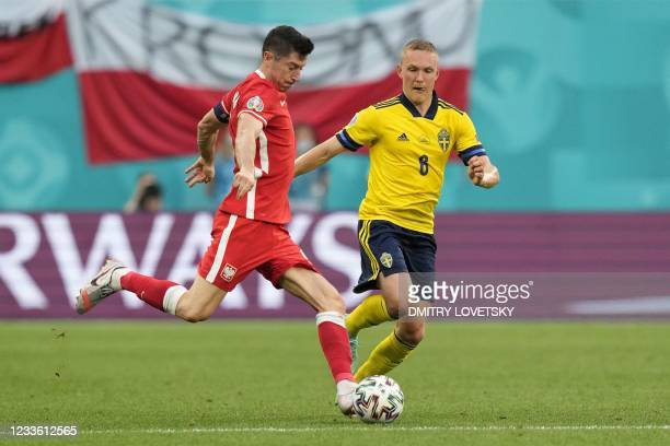 Poland's forward Robert Lewandowski fights for the ball with Sweden's defender Ludwig Augustinsson during the UEFA EURO 2020 Group E football match...