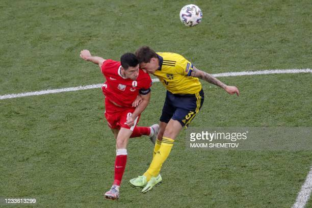 Poland's forward Robert Lewandowski fights for the ball with Sweden's defender Victor Lindelof during the UEFA EURO 2020 Group E football match...
