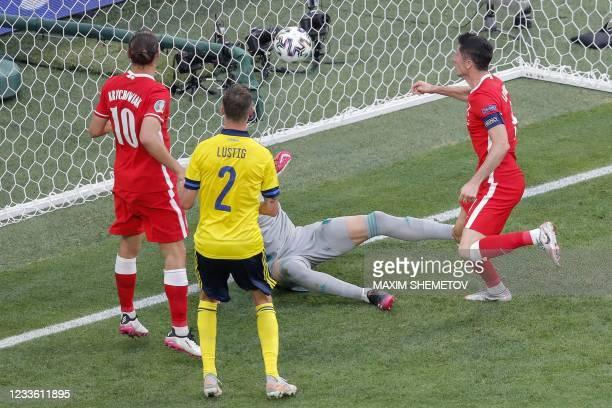 Poland's forward Robert Lewandowski heads teh ball and hits the goal post during the UEFA EURO 2020 Group E football match between Sweden and Poland...