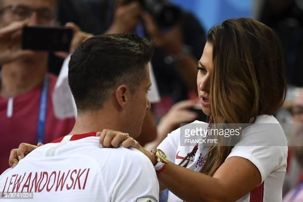 TOPSHOT Poland's forward Robert Lewandowski is comforted by his wife Anna Lewandowska at the end the Russia 2018 World Cup Group H football match...