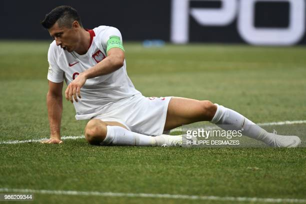 TOPSHOT Poland's forward Robert Lewandowski lies on the pitch during the Russia 2018 World Cup Group H football match between Japan and Poland at the...