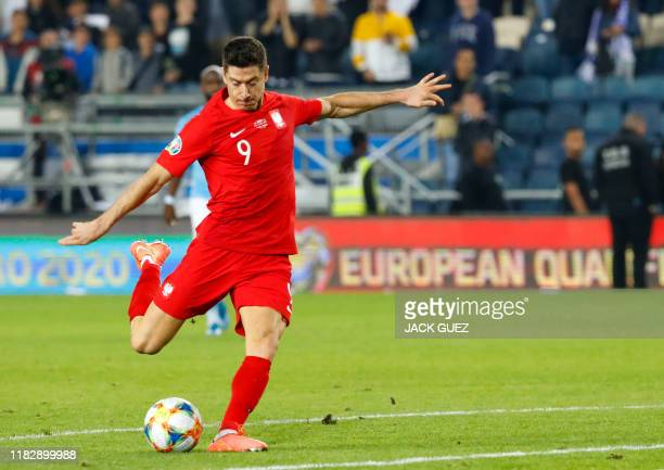 Poland's forward Robert Lewandowski prepares to shoot the ball during the EURO 2020 group G qualifiers football match between Israel and Poland at...