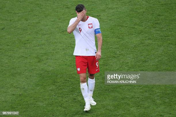TOPSHOT Poland's forward Robert Lewandowski reacts after being defeated by Colombia at the end of the Russia 2018 World Cup Group H football match...