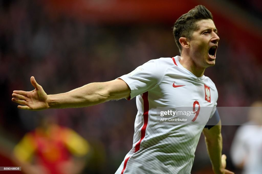 Poland's forward Robert Lewandowski reacts after he scored a goal during the FIFA World Cup 2018 qualification football match between Poland and Montenegro in Warsaw on October 8, 2017. /