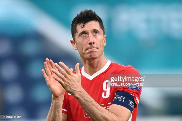 Poland's forward Robert Lewandowski reacts after losing the UEFA EURO 2020 Group E football match between Sweden and Poland at Saint Petersburg...