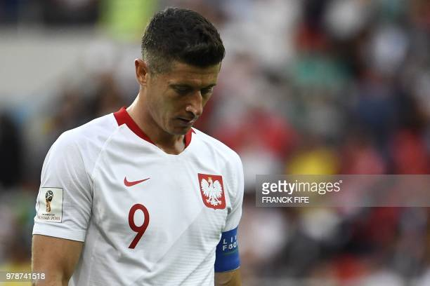 TOPSHOT Poland's forward Robert Lewandowski reacts during the Russia 2018 World Cup Group H football match between Poland and Senegal at the Spartak...