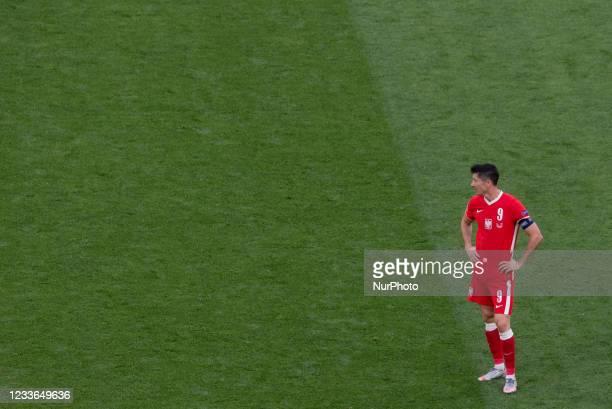 Poland's forward Robert Lewandowski reacts during the UEFA EURO 2020 Group E football match between Sweden and Poland at Saint Petersburg Stadium in...