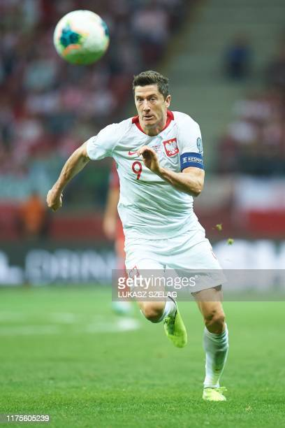 Poland's forward Robert Lewandowski runs with the ball during the Euro 2020 qualifier Group G football match Poland v Macedonia in Warsaw, Poland, on...