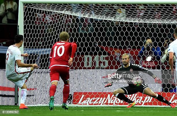 Poland's forward Robert Lewandowski scores a penalty against Denmark's goalkeeper Kasper Schmeichel during the 2018 World Cup qualifier football...