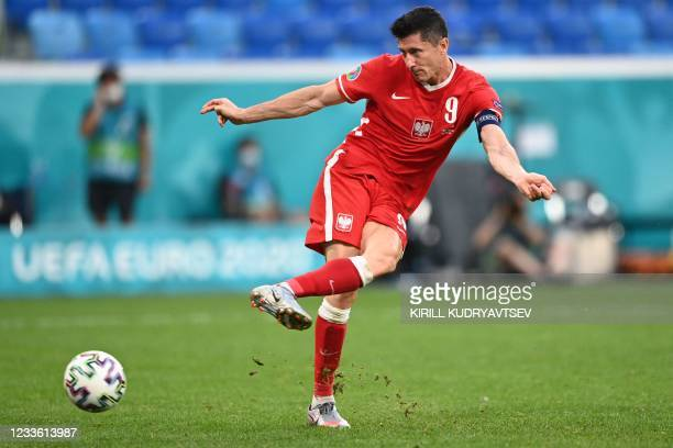 Poland's forward Robert Lewandowski shoots and scores his team's second goal during the UEFA EURO 2020 Group E football match between Sweden and...