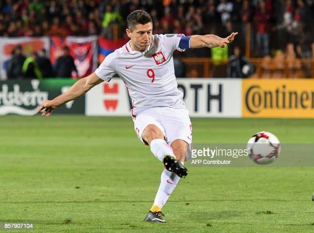 Poland's forward Robert Lewandowski shoots the ball during the FIFA World Cup 2018 qualification football match between Armenia and Poland in Yerevan...