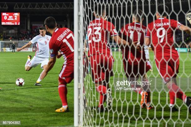 Poland's forward Robert Lewandowski takes a free kick to score the team's third goal during the FIFA World Cup 2018 qualification football match...
