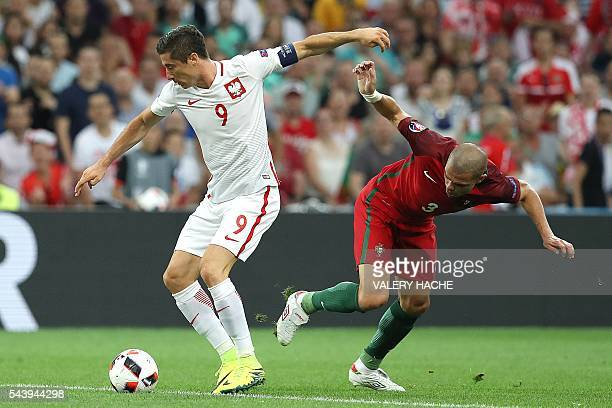 TOPSHOT Poland's forward Robert Lewandowski vies with Portugal's defender Pepe during the Euro 2016 quarterfinal football match between Poland and...