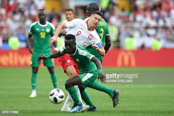 TOPSHOT Poland's forward Robert Lewandowski vies with Senegal's defender Kalidou Koulibaly and Senegal's midfielder Idrissa Gana Gueye the Russia...