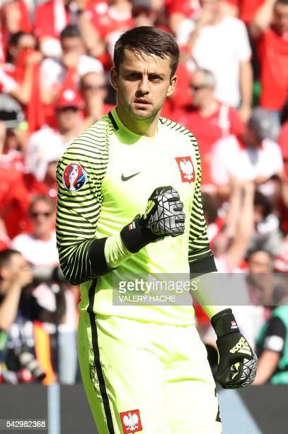 Poland's goalkeeper Lukasz Fabianski reacts as Switzerland's midfielder Granit Xhaka failed to score during penalty shootout during the Euro 2016...