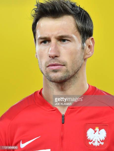 Poland's Gregorz Krychowiak listens to the Polish national anthem before the Euro 2020 football qualification group G match between Austria and...