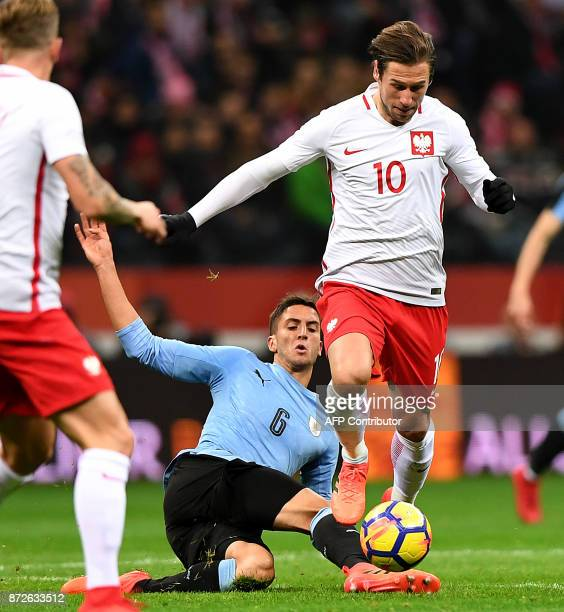 Poland's Grzegorz Krychowiak and Uruguay's Rodrigo Bentancur vie for the ball during their international friendly football match between Poland and...