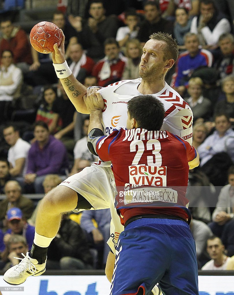 Poland's Grzegorz Tkaczyk in action against Serbia's Nenad Vuckovic during the Men's European Handball Championship group A match between Poland and Serbia at Pionir Sports Centre on January 15, 2011 in Belgrade, Serbia.