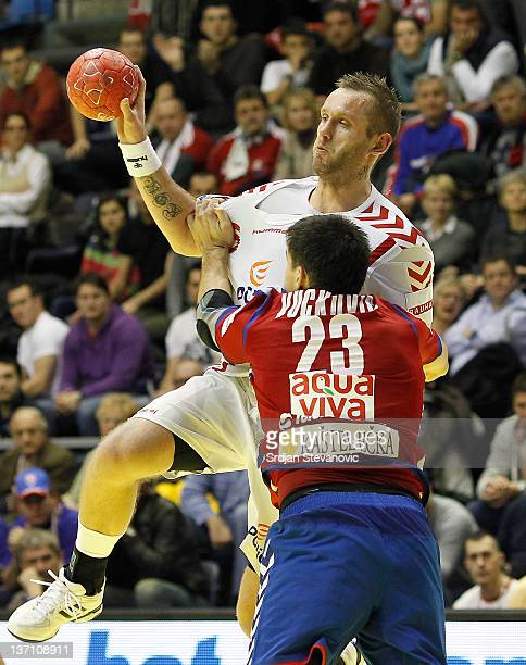 Poland's Grzegorz Tkaczyk in action against Serbia's Nenad Vuckovic during the Men's European Handball Championship group A match between Poland and...