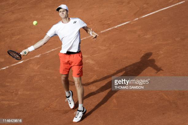 Poland's Hubert Hurkacz plays a forehand return to Serbia's Novak Djokovic during their men's singles first round match on day two of The Roland...