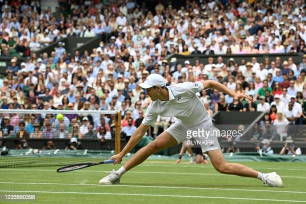 Poland's Hubert Hurkacz returns against Italy's Matteo Berrettini during their men's singles semi-final match on the eleventh day of the 2021...