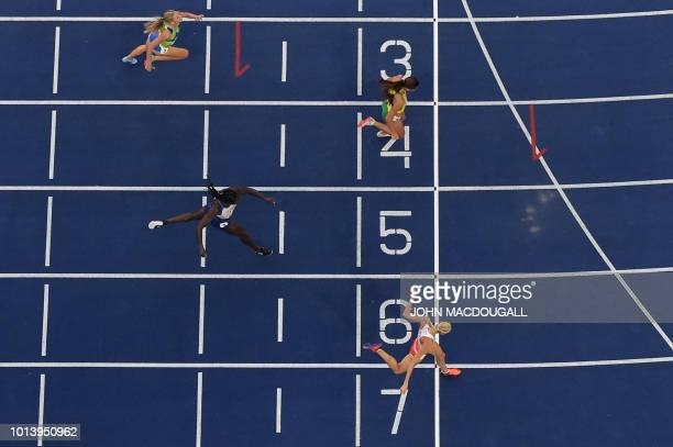 Poland's Iga BaumgartWitan wins the women's 400m semifinal race during the European Athletics Championships at the Olympic stadium in Berlin on...