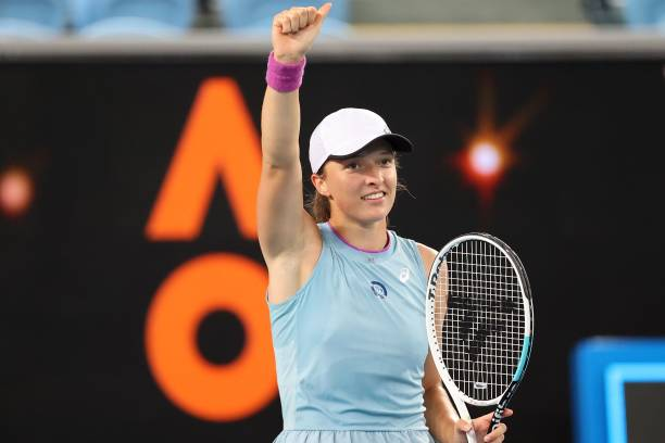 Poland's Iga Swiatek celebrates after victory against France's Fiona Ferro during their women's singles match on day five of the Australian Open...