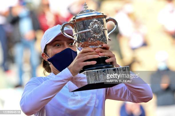 Poland's Iga Swiatek celebrates with the Suzanne Lenglen trophy during the podium ceremony after winning the women's singles final tennis match...