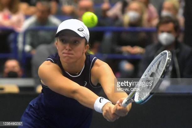Poland's Iga Swiatek returns the ball to Greece's Maria Sakkari during their women's singles semi-final match of the Ostrava Open WTA tennis...