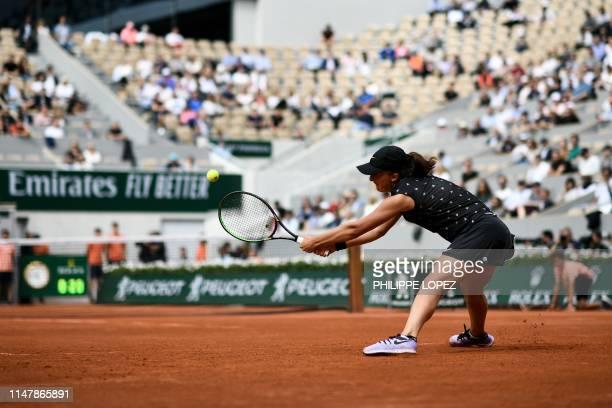 Poland's Iga Swiatek returns the ball to Romania's Simona Halep during their women's singles fourth round match on day nine of The Roland Garros 2019...