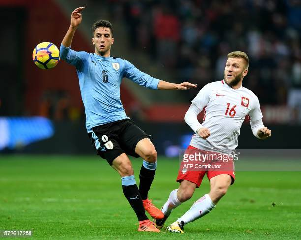 Poland's Jakub Blaszczykowski and Uruguay's Rodrigo Bentancur vie for the ball during the friendly football match between Poland and Uruguay at...