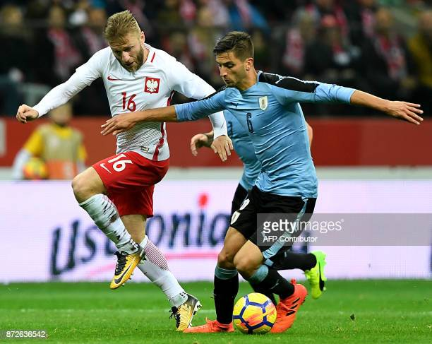 Poland's Jakub Blaszczykowski and Uruguay's Rodrigo Bentancur vie for the ball during their international friendly football match between Poland and...