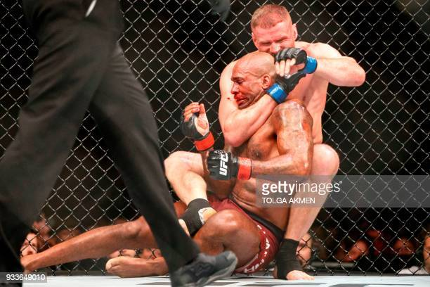 TOPSHOT Poland's Jan Blachowicz grapples with British fighter Jimi Manuwa in their Light Heavyweight fight during the UFC Fight Night at the O2 Arena...