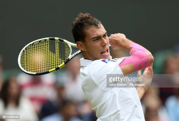 Poland's Jerzy Janowicz in action against Spain's Nicolas Almagro during day five of the Wimbledon Championships at The All England Lawn Tennis and...