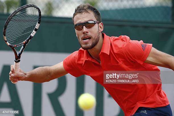 Poland's Jerzy Janowicz returns the ball to France's Maxime Hamou during the men's first round of the Roland Garros 2015 French Tennis Open in Paris...