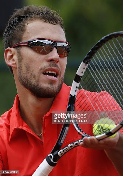 Poland's Jerzy Janowicz serves against France's Maxime Hamou during the men's first round of the Roland Garros 2015 French Tennis Open in Paris on...