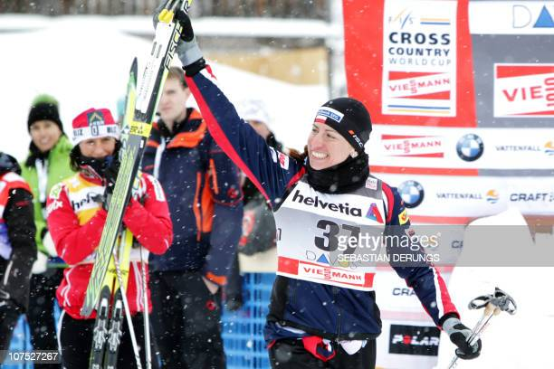 Poland's Justyna Kowalczyk celebrates on December 11 2010 after placing second in the women's nordic skiing World Cup 10km classic individual race in...