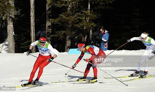 Poland's Justyna Kowalczyk Norway's Marit Bjoergen and Sweden's Anna Olson compete in the women's Nordic Cross Country individual sprint final at...