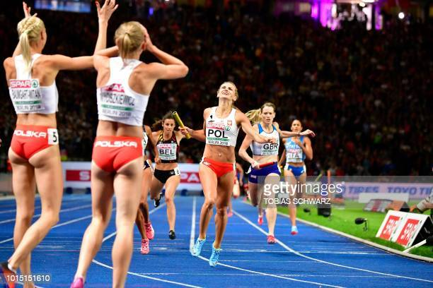 Poland's Justyna SwietyErsetic crossees the finish line in the women's 4x400m relay final during the European Athletics Championships at the Olympic...