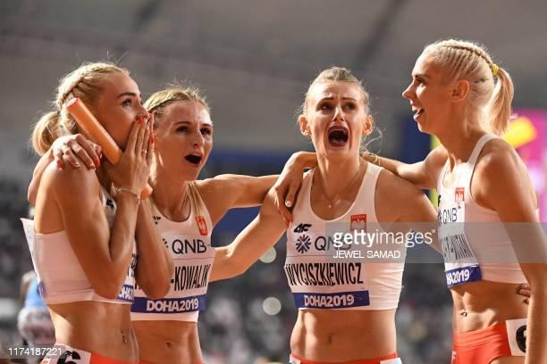 Poland's Justyna SwietyErsetic Poland's Malgorzata HolubKowalik Poland's Patrycja Wyciszkiewicz and Poland's Iga BaumgartWitan react after finishing...