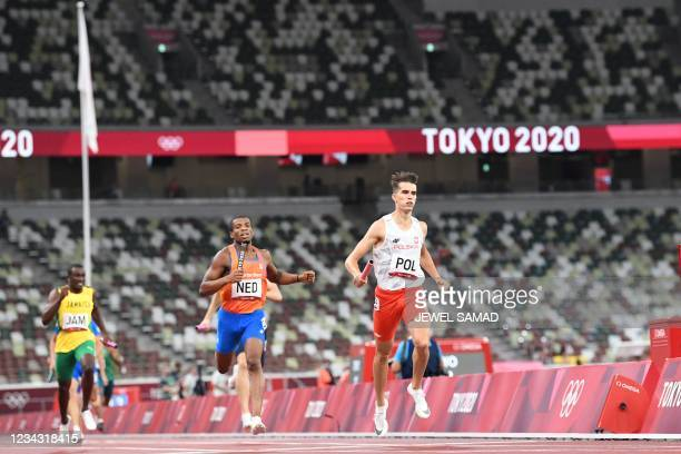 Poland's Kajetan Duszynski and Netherlands' Ramsey Angela and Jamaica's Karayme Bartley compete in the mixed 4x400m relay heats during the Tokyo 2020...