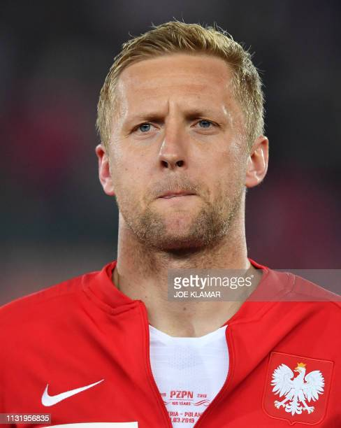 Poland's Kamil Glik listens to the Polish national anthem before the Euro 2020 football qualification group G match between Austria and Poland at...