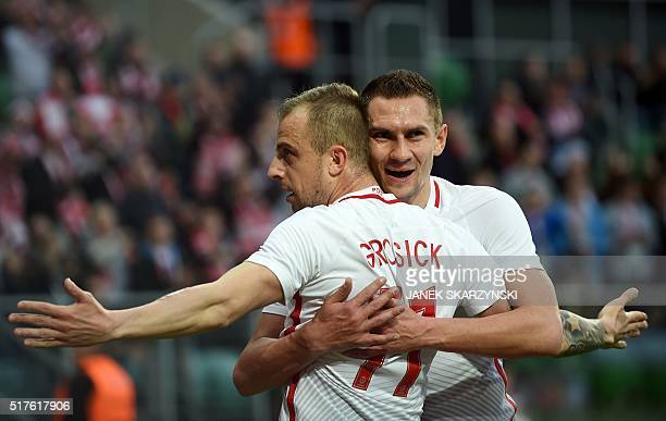 Poland's Kamil Grosicki and Artur Jedrzejczyk celebrate after Grosicki scored a goal against Finland during the friendly football match between...