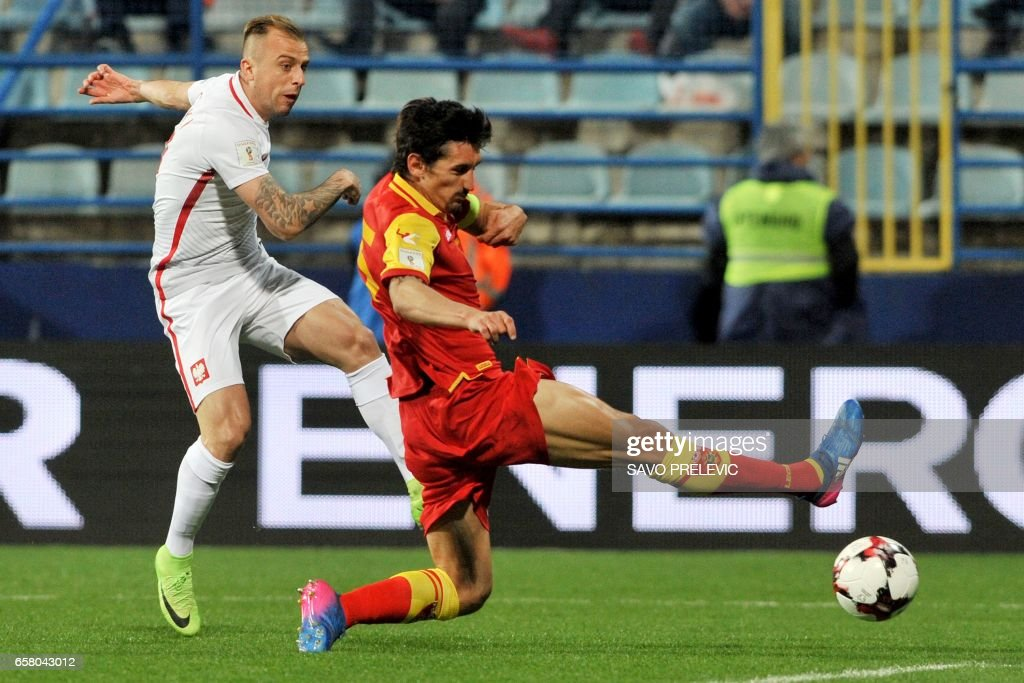 Poland's Kamil Grosicki (L) kicks the ball past Montenegro's Stefan Savic during the FIFA World Cup 2018 qualification football match between Montenegro and Poland in Podgorica on March 26, 2017. /
