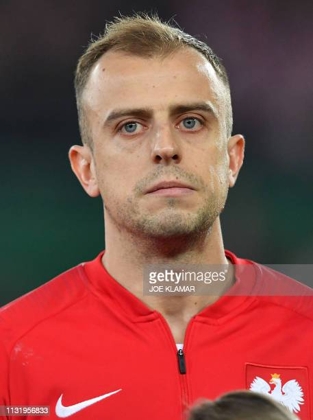 Poland's Kamil Grosicki listens to the Polish national anthem before the Euro 2020 football qualification group G match between Austria and Poland at...