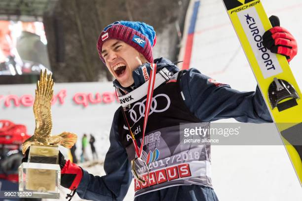 Poland's Kamil Stoch celebrates the victory at the Four Hills Tournament with his trophy in Bischofshofen Austria 06 January 2018 Stoch won in...